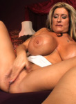 Blonde bombshell rubs her snatch